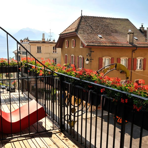 "Seat & flower boxes on Lake Geneva view ""L"" Large Rooms private balcony overlooking Montreux city"