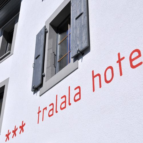 Historic shuttered window above the sign for the Tralala Hotel in Montreux, Switzerland