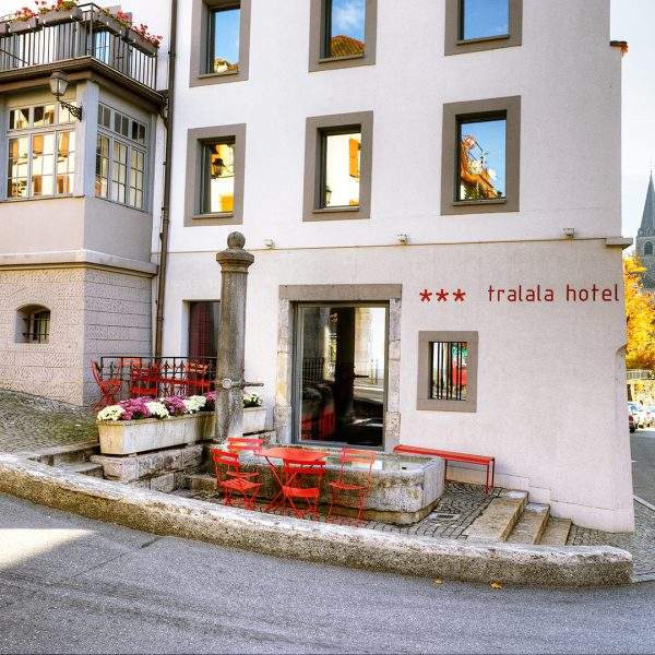 Outdoor view of Tralala Riviera Hotel on the corner of a historic street in the centre of Montreux