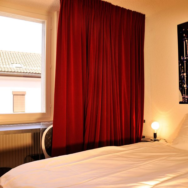 "Twin bed & city view window in 2 person ""S"" Small Rooms at Montreux Hotel Tralala, Switzerland"