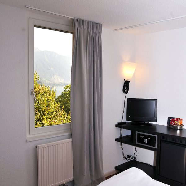 TV, safe & Lake Geneva view window in the Tralala Montreux Riviera Hotel Large Rooms in Switzerland