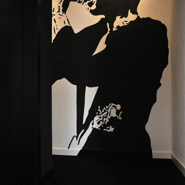 "Artwork of a Jazz singer in the music themed ""XL"" penthouse Luxury Suites at Tralala Hotel Montreux"