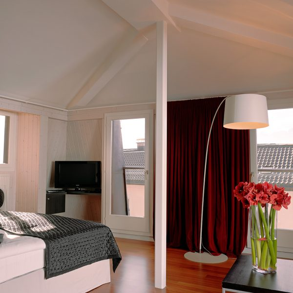 "Bed facing windows in ""XL"" penthouse Luxury family Suite at Tralala Hotel Montreux in Switzerland"