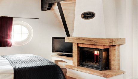 "Fireplace & bed in ""XL"" luxury suites accommodation at Tralala Hotel Montreux on the Swiss Riviera"
